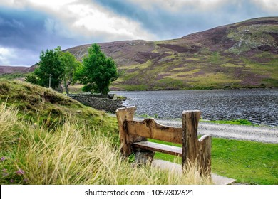 Wooden bench at Loch Lee, Angus, Aberdeenshire, Scotland, UK. Cairngorms, south of the Grampian Mountains.