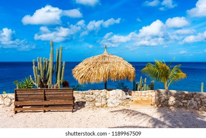 Wooden bench on the background of the sea landscape in Playa Lagoon, Curacao, the Netherlands. Copy space for text