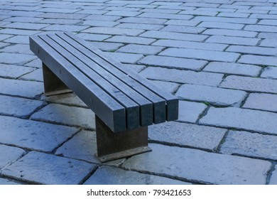 Wooden Bench on an old roman pavement