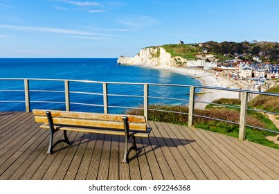Wooden bench on viewpoint over  Etretat, Normandy, France. Popular touristic destination