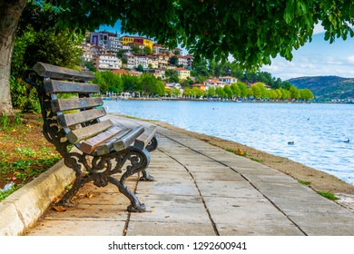A wooden bench on waterfront of Kastoria, Greece