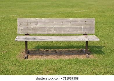 Wooden bench over green grass