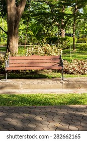 A wooden bench at the park in summer