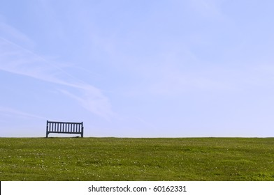 wooden bench in the park under blue sky