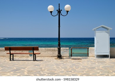 Wooden bench with a sea view at midday