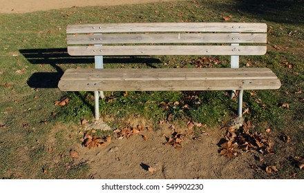 Wooden bench in the sun