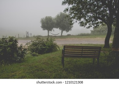 Wooden Bench with View on the countryside in the autumn mist