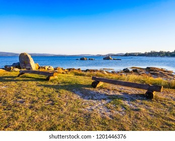 Wooden benches to look the sea in Arousa Island, Galicia, Spain