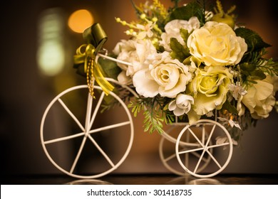 Wooden bicycle toy for decorative with artificial flowers