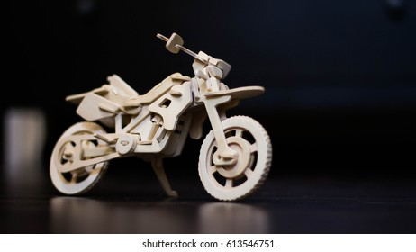 wooden bike, motorcycle of wood on the floor, wooden model motorcycle