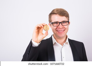 Wooden Bitcoin in funny man hand, Digital symbol of a new virtual currency