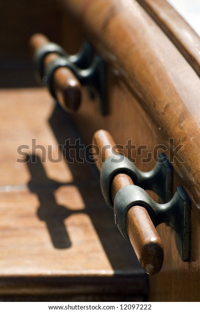 Wooden bitts with shadow on a sailboat