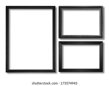 The wooden black frame on the white background