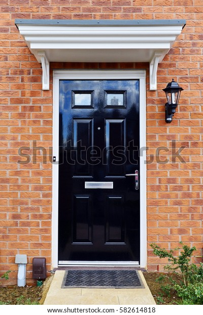 Wooden Black Front Door of a Red Brick London Town House