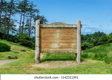 Wooden blank billboard with empty space in a park on a sunny day, Oregon, usa.