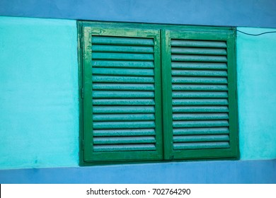 Wooden blinds to the window