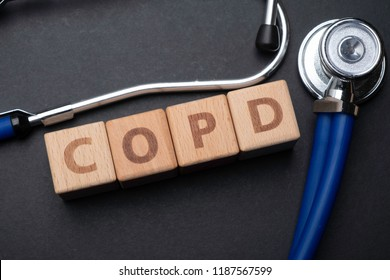 Wooden block form the word COPD (Chronic obstructive pulmonary disease) with stethoscope. Medical concept.