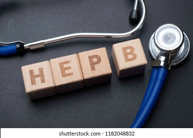Wooden block form the word HEP B with stethoscope. Medical concept.