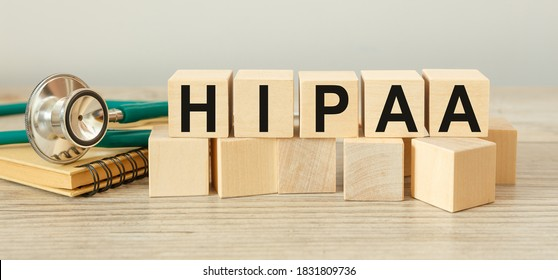 Wooden block form the word HIPAA - The Health Insurance Portability and Accountability Act of 1996. Medical concept.
