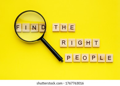 wooden block lettering find the right people and magnifying glass on yellow background.
