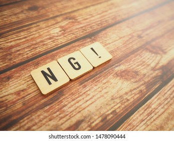 Wooden block with NG word, vintage style