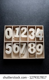 Wooden block numeric set over dark  background, from above