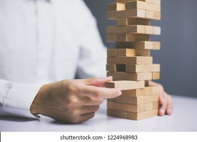 Wooden block Planning, risk and strategy of project management in business, with hand pull wood block.