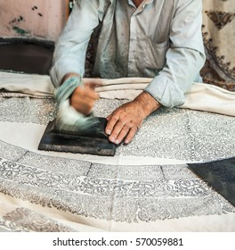 Wooden block printing for textile.Iran traditional process.