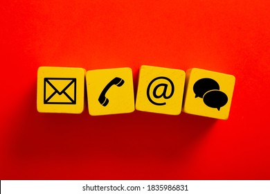 Wooden block with symbol telephone, email, address and comunication. Conceptual of contact us and e-mail marketing concept.