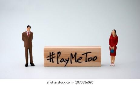 Wooden block written as #PayMeToo. Newsocialmovementforequalpay.