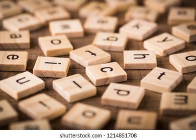 Wooden blocks alphabet on the wooden table.
