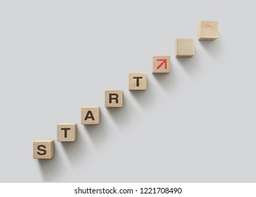 Wooden blocks arranged in stair shape with the word START. Start, Start up, new career or new business, start to success or mindset concept.