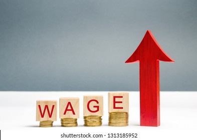Wooden blocks with coins and the word Wage and up arrow. Increase of salary. Wage rates. Career growth. Increase profits and family budget. Promotion. The career ladder is growing