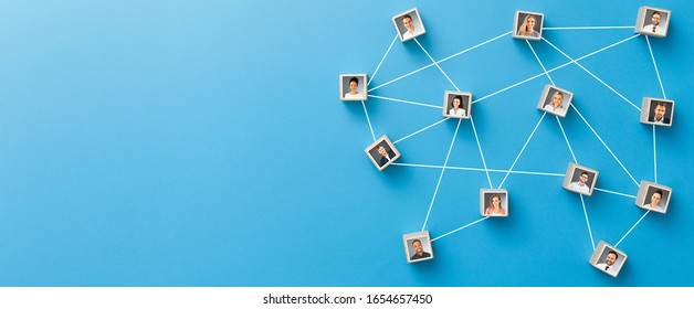 Wooden blocks connected together on blue background. Teamwork, network and community concept.