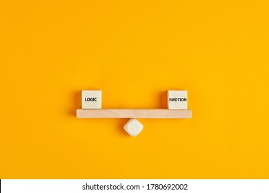 Wooden blocks designed as a seesaw with the concepts of logic and emotion are in balance.. Concept of balancing logic and emotion in life or decision making.