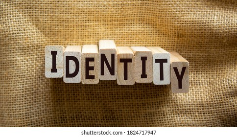 Wooden blocks form the words 'identity' on beautiful canvas background. Business concept. Copy space.