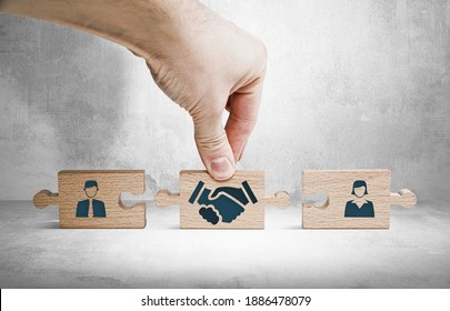 Wooden blocks with an icon of a woman and a man and mediation. Concept of mediation between spouses, divorce. Divorce proceedings before the Court. The role of the mediator.