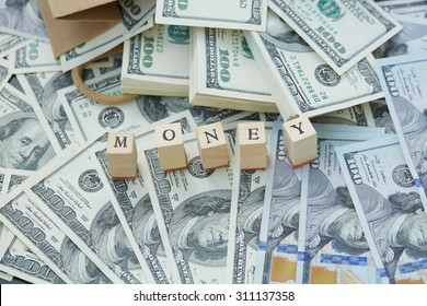 Wooden blocks - the inscription money. a lot of money out of a paper bag