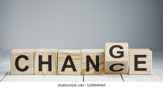 """Wooden blocks with letters forming words """"Chance"""" and """"Change"""" on neutral background"""