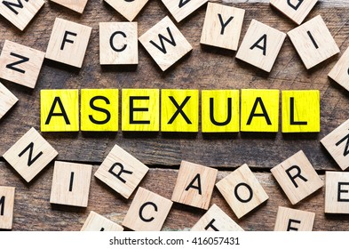 Wooden blocks with letters spelling asexual. Wooden blocks with letters spelling asexual on wooden background.