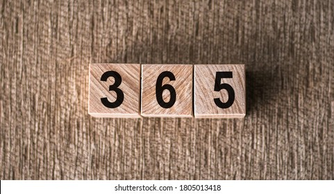 Wooden blocks letters spelling out the word and numbers 365 days