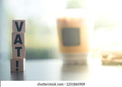 Wooden blocks with letters VAT. VAT is acronym from word Value Added Tax. Vat payment from customer in super market : Government Vat from goods