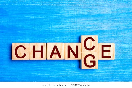 Wooden blocks with letters and words change and chance. The concept of self-motivation, self-development and improvement of personal qualities. Chance to change. Way to success.