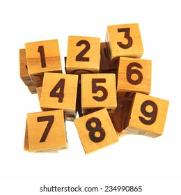 Wooden blocks with numbers from one to nine over white background