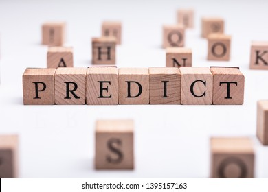 Wooden Blocks With Predict Word Over White Desk
