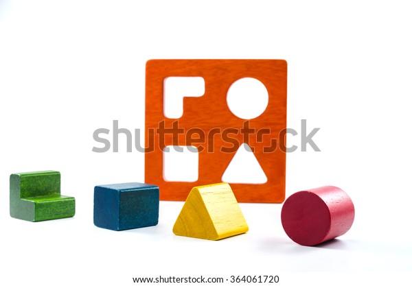 wooden blocks shape sorter toy isolated on white background