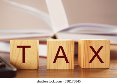 Wooden blocks with space for text on table, closeup. Tax concept