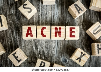 Wooden Blocks with the text: Acne