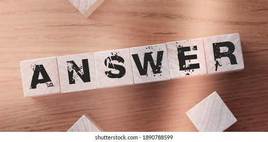 Wooden Blocks with the text: Answers. Questions and answers support desk Expert consulting business concept.