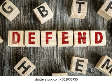 Wooden Blocks with the text: Defend